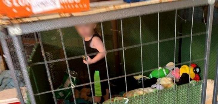 niño jaula animales